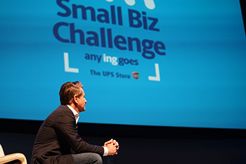Robert Herjavec onstage observing contestants at The UPS Store 2019 Small Biz challenge