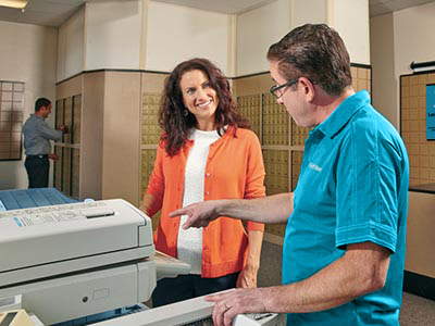 Associate showing customer printer options