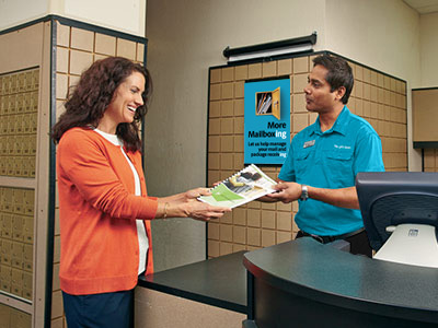 Associate showing customer print products