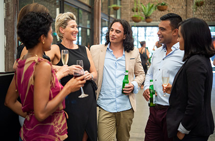 A group of professionals chatting at an upscale networking event