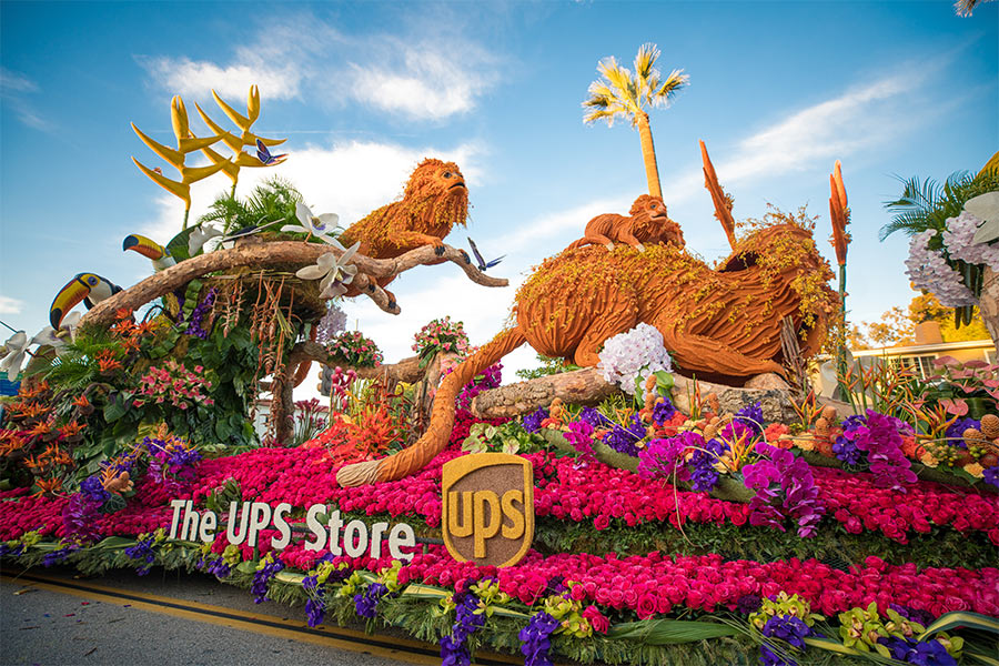 The UPS Store's 2020 Rose Parade float featuring monkeys, birds and flowers