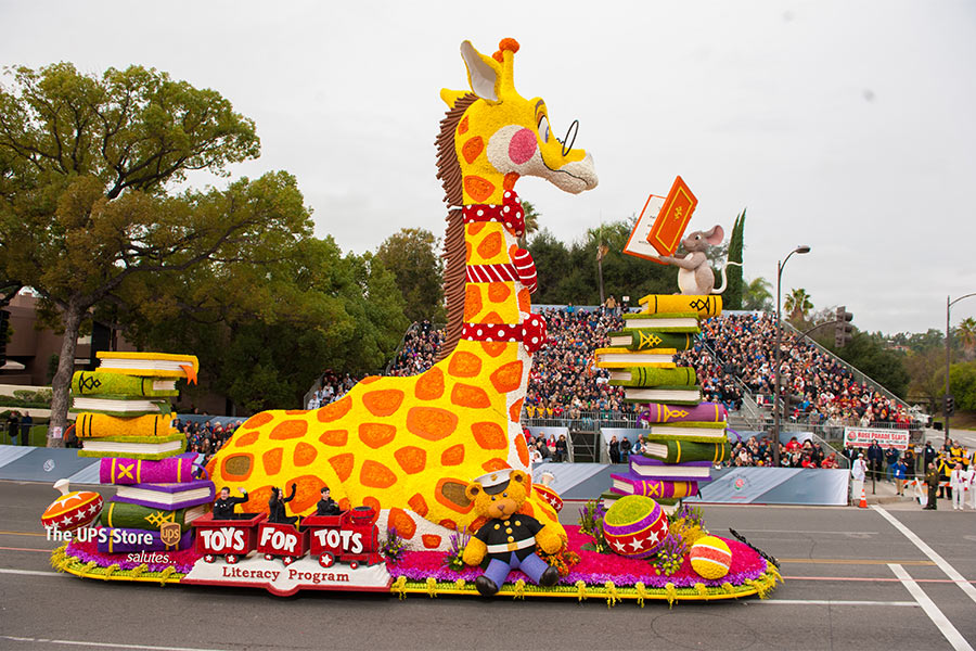 The UPS Store's 2017 float, featuring a 42 foot giraffe with animal friends