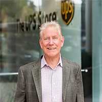 Headshot image of Don Higginson standing outside of The UPS Store headquarters