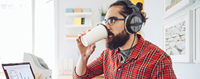 Man with headphones drinking coffee