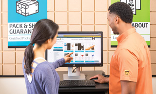 customer and store associate viewing a website