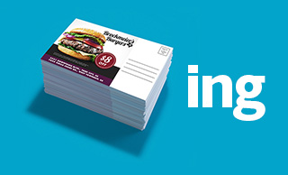 Stack of fast food direct mail coupons on a blue background next to the letters ING