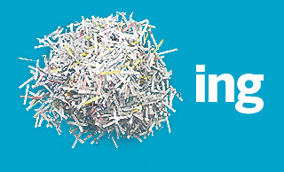 Pile of shredded paper against a blue background next to the letters