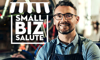 small business owner in apron smiling with the Small Biz Salute logo embedded