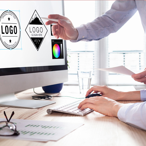 Small business owner reviewing logo designs for their marketing plan