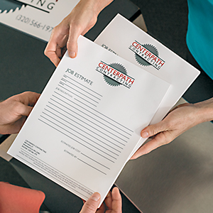 Woman handing reports to customer