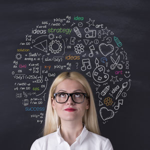Woman in front of chalk Board