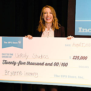 Pitch off winner holding giant check photo