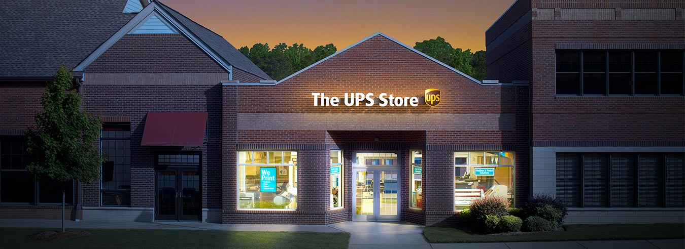 Exterior photo of a The UPS Store location at night