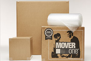3 moving boxes and roll of cushion wrap