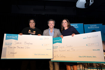Robert Herjavec (middle) presents Small Biz Challenge winners Samia Bingham and Ingrid Sanden with their grand prize checks.
