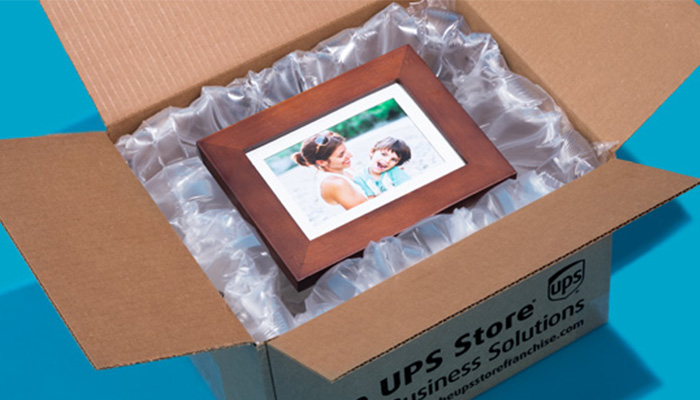 UPS box with a framed picture of a mother holding her son