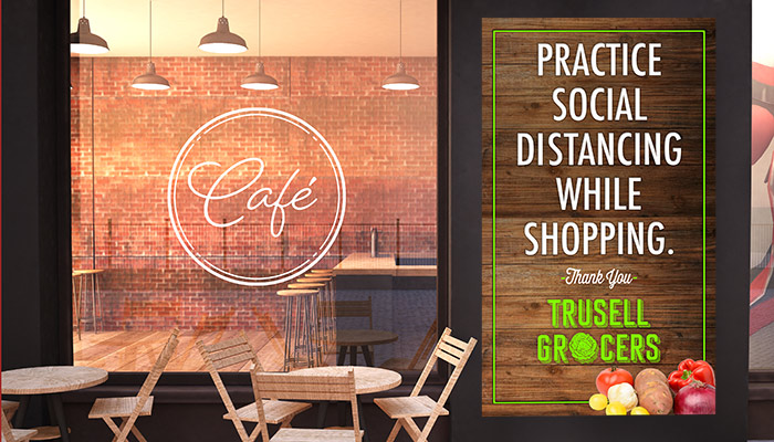 Large social distancing poster outside of a grocery store and cafe