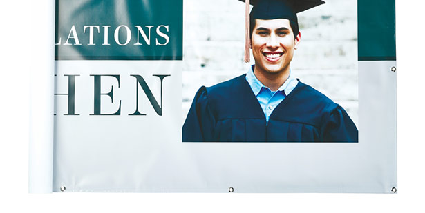 banner showing college graduate