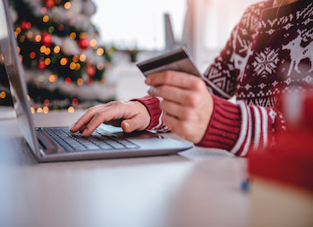 person holiday shopping on laptop