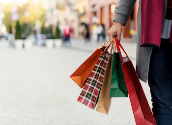 lady holiday shopping with bags