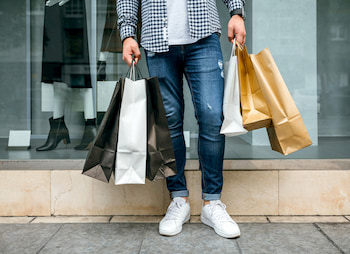customer with retail shopping bags
