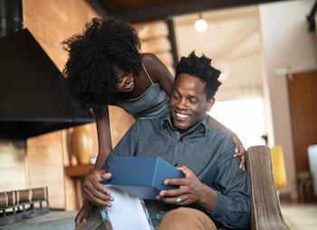 man and woman looking at a gift box