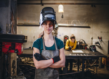 woman in working in a machine shop