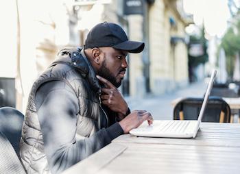 man on laptop outdoors