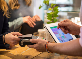 person paying with cashless payment