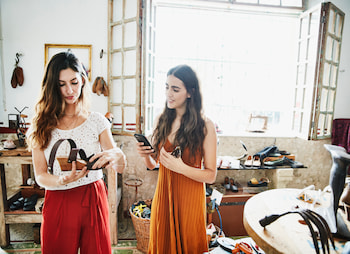 two women looking at shoes
