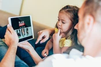 Family seeing sales on tablet