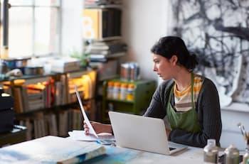 woman managing finances on her laptop