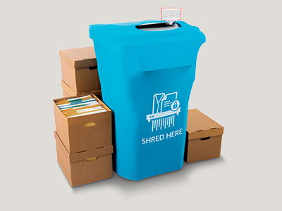 Customer placing documents into shredding bin