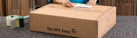 The UPS Store shipping box with tape