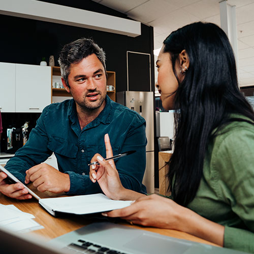 Woman sitting with a man during a business consultation