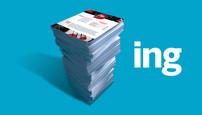 Image of a stack of neatly printed copies and flyers