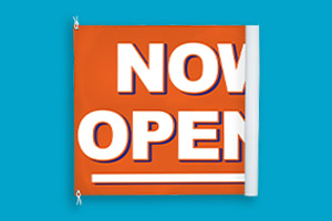 A vinyl banner that says Yes, We're Open
