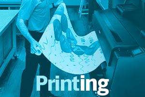 Large format banner for a birthday being printed in store